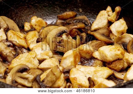 fried mushrooms in a pan closeup