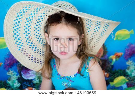 Child wearing a sun hat