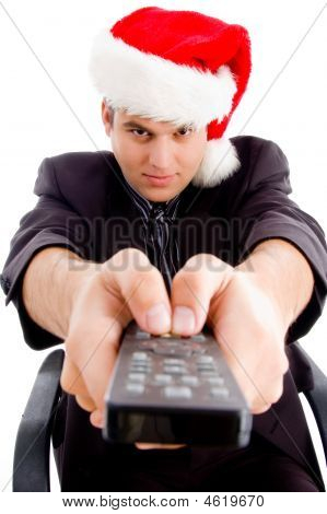 Man Holding Remote Control And Wearing Christmas Hat