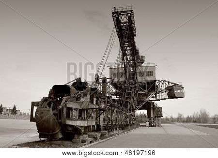 an old coal digger is in a disused mine