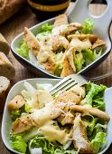 stock photo of caesar salad  - fresh caesar salad on bowl with parmesan cheese - JPG