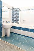 foto of lavabo  - Interior shot of bathroom with blue tiles - JPG