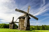 Two Old Wooden Windmills