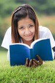 Young Women Open A Book