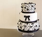 picture of communion  - Wedding cake decorated with fondant on a table - JPG