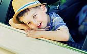 picture of car ride  - little boy sitting in the car - JPG