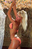 stock photo of bimbo  - Beautiful young woman at the summer lounge - JPG
