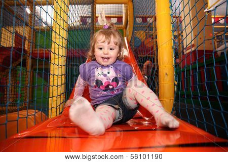 Little girl on a slide