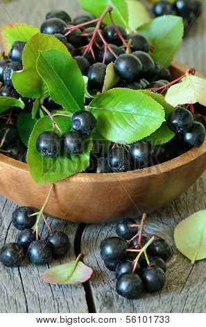 Black Chokeberry On Wooden Table