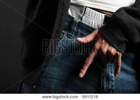 I love you gesture in front of blue jeans with underwear sticking out of pants