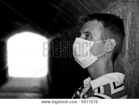 Male With Gauze Bandage In Dark Tunnel