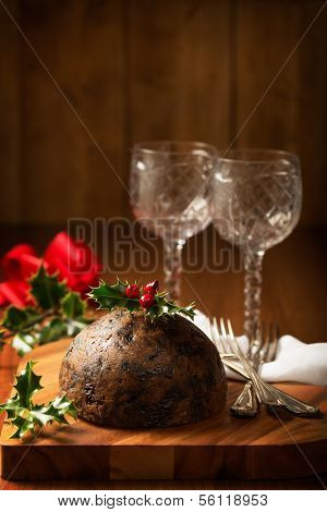 Christmas pudding with holly and berries