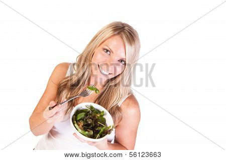 A healthy woman with salad on white background
