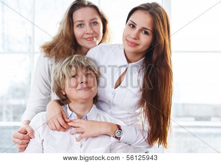 Portrait Of A Mature Mother And Adult Daughter And Teen Granddaughter