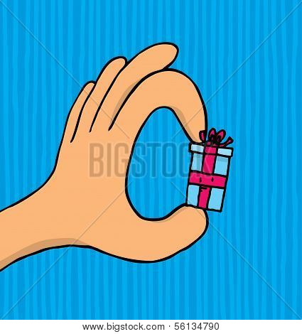Hand Holding A Small Tiny Gift