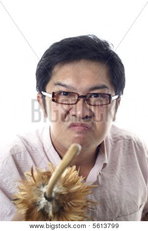 Angry teacher with feather duster cane