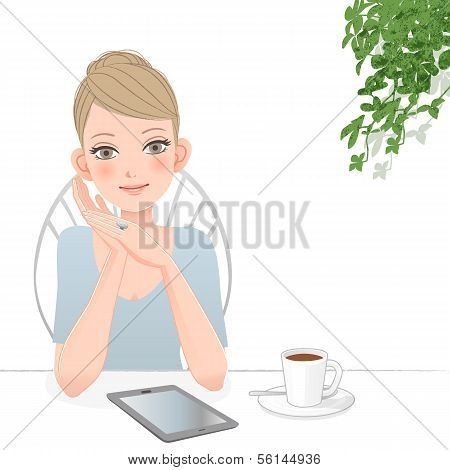 Beautiful Woman With Tablet Computer At Café