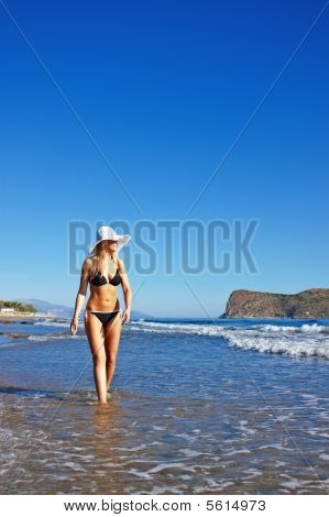 Young Smiling Blond Woman In Black Bikini
