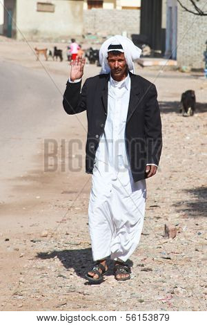 EGYPT - FEBRUARY 2: Bedouin man walking in the street on February 2, 2011 in Dahab, Egypt. Traditionally nomadic, the bedouins nowadays have settled in towns.