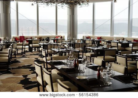 HONG KONG - MARCH 27, 2013: empty restaurant in Crowne Plaza Hotel in Hong Kong, China on 27 March 2013.Crowne Plaza is a chain of luxury hotels which offers high quality services all over the world