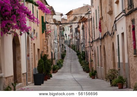 Street in old town of Alcudia . Majorca Spain