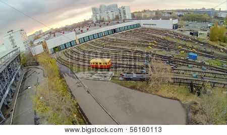 Yellow waggon near the gates of metro depot, view from unmanned quadrocopter.
