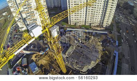 Construction with crane where workers are building a new house, view from unmanned quadrocopter.