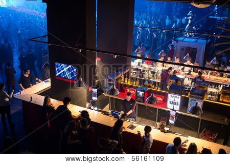 MOSCOW - DEC 8: People buy drinks in the bar near the dancefloor with showgirls on GLOBALCLUBBING Mind Games in Stadium Live on December 8, 2013 in Moscow, Russia.