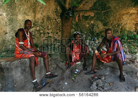 Three Young Africans, Masai Clothing, Rest In The Shade.