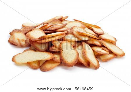 a pile of homemade spanish cookies lenguas de gato on a white background
