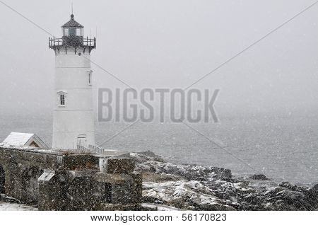 Lighthouse During Snowstorm