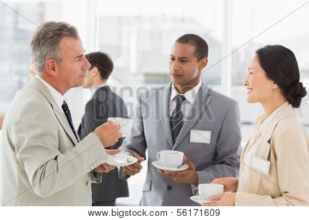 Business people talking and having coffee at a conference in the office