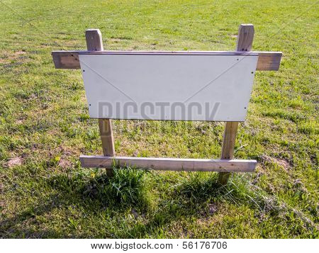 in a meadow there is a sign