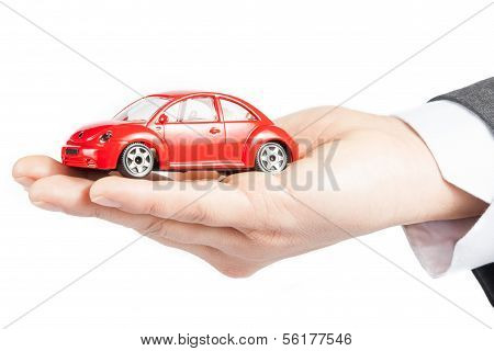 Toy Car In The Hand Of Business Man Concept For Insurance, Buying, Renting, Fuel Or Service And Repa