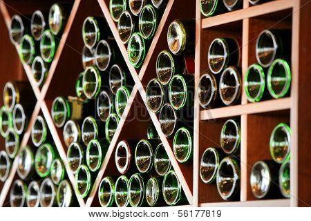 Lots of wine bottles stored in the racks