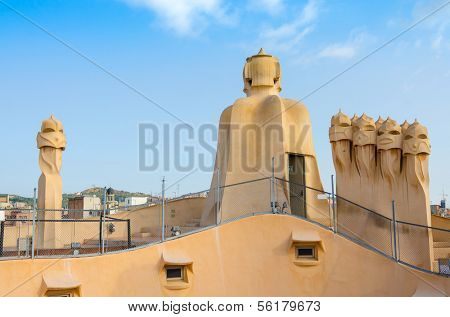BARCELONA, SPAIN - SEPTEMBER 9, 2013: Chimneys on Casa Mila (La Pedrera), building constructed between 1906 and 1912 by the architect Antoni Gaudi and declared UNESCO World Heritage