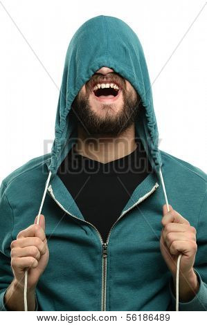 Young man with beard pulling hood over head isolated over white background