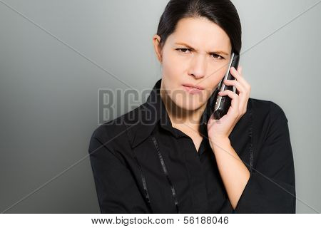 Nervous Woman Chatting On Her Mobile