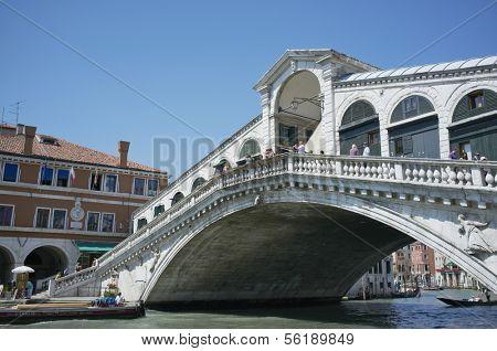 VENICE, VENETO, ITALY - MAY 24, 2011: Famous Rialto bridge on Grand Canal. May 24, 2011 in Venice, Veneto, Italy