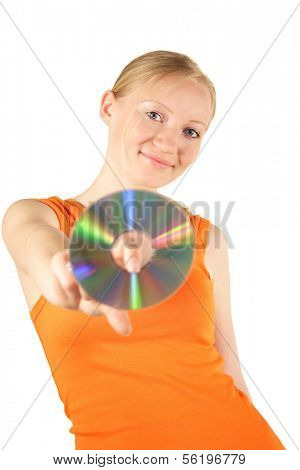 An attractive young woman holding a cd or dvd.