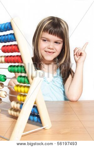 A young girl learning maths by using a sliding rule. All isolated on white background