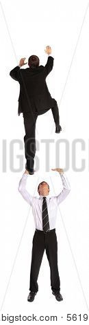 Two young business men climbing upwards. All isolated on white background.
