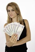 stock photo of dirhams  - Blonde Tourist Wins Money In The Local Currency Of Dirhams In Dubai - JPG