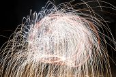 stock photo of poi  - Poi, created to burst fireworks while spinning.