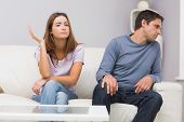 stock photo of not talking  - Unhappy couple not talking after argument at home on the couch - JPG