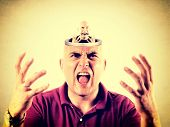 stock photo of bad teeth  - Angry bald man with open head with himself in it - JPG