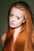 image of auburn  - Face of Fanciful Red Hair Woman with Creative Stagy Art Make - JPG