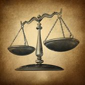 foto of judiciary  - Justice scale with grunge texture as a symbol of law on a vintage parchment texture as a concept for the old legal system in government and society and enforcing historic rights and regulations - JPG