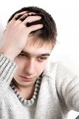 stock photo of pity  - sad young man portrait at the home - JPG