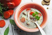 stock photo of buckwheat  - Meatball soup and buckwheat in a bowl on the table - JPG